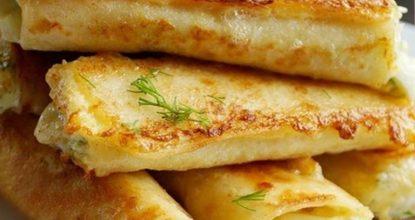 Трубочки из лаваша, начинённые вареным яйцом и тёртым сыром